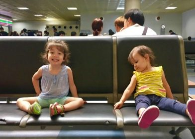 two toddler girls waiting at gimpo airport