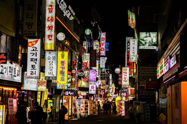 a lot of neon signs representing Seoul's busy nightlife
