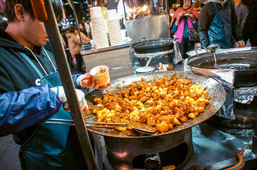 fried chicken at myeongdong night market, hotels in myeongdong