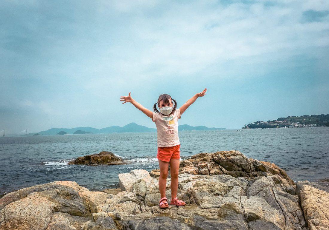 girl on rock near Maemi Castle on Geoje Island