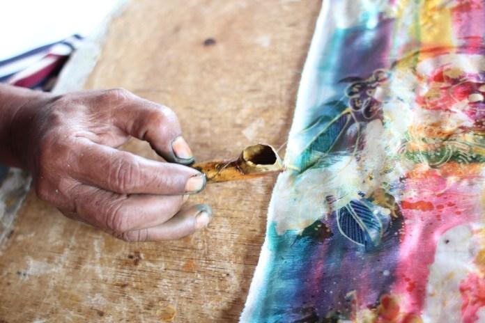 Batik painting in bali when it rains