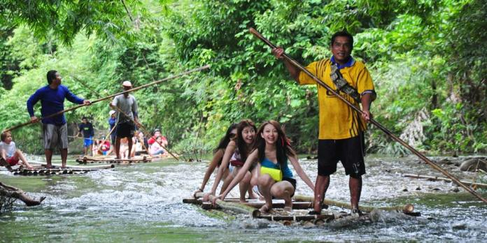 Try your hand at bamboo rafting in beautiful Lam Ru National Park