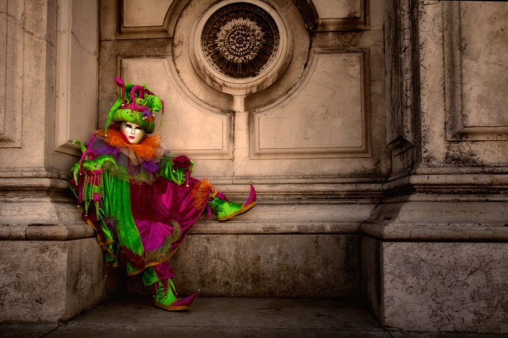 Carnival costumed model sitting outside San Gorgio church