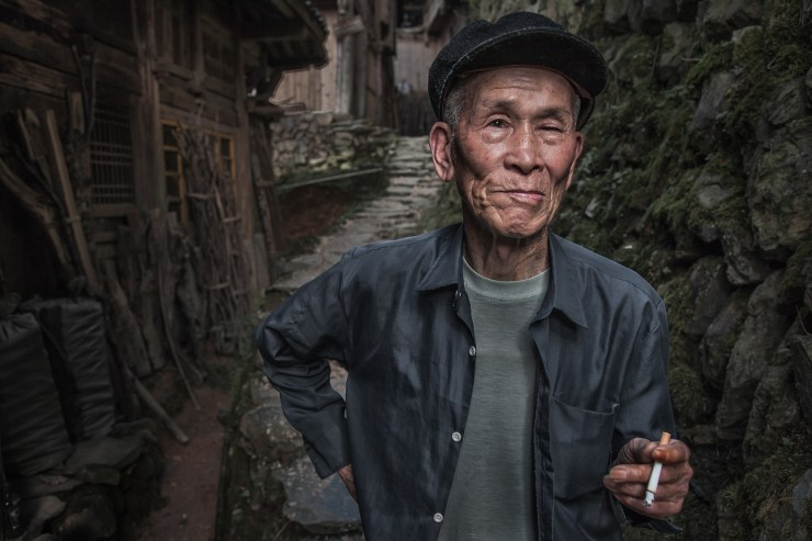 Chinese man from the Longji area takes a break outside his house. He was a natural model who had great expressions.