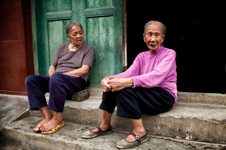 Older Chinese women sitting on the stairs. Although I took this image in 2012, I was back in 2015 and found the same women, sitting on the same stairs, and wearing the same clothes.