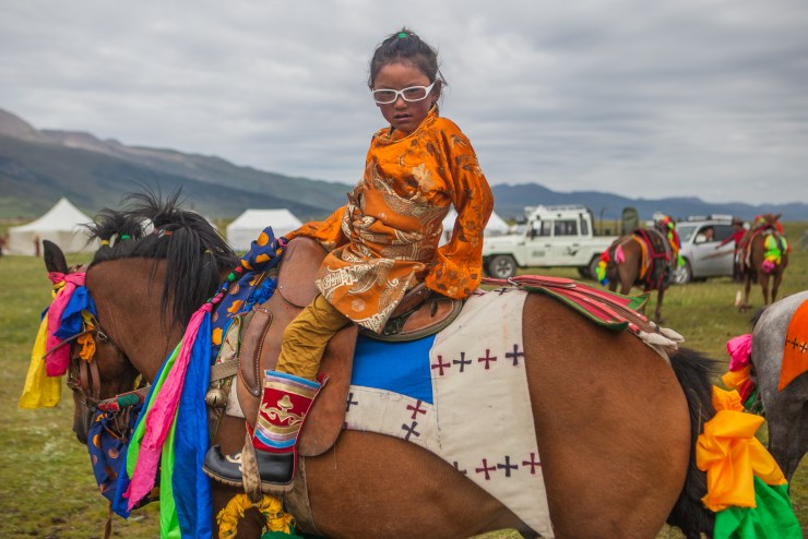 young-tibetan-girl-on-her-fathers-racing-horce_10379467804_o