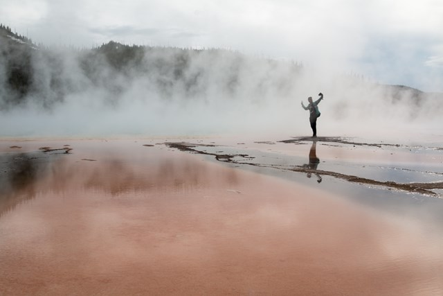 People Walk on Grand Prismatic Spring YellowStone3