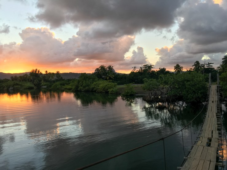 The sun sets over the swinging bridge in Baracoa.