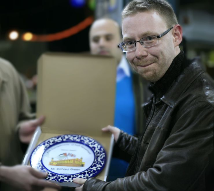 Richard Green receiving a plate in Palestine