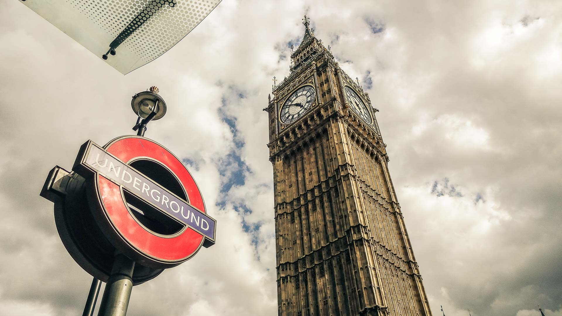 Big Ben and Underground sign in London, England. How expensive is London?