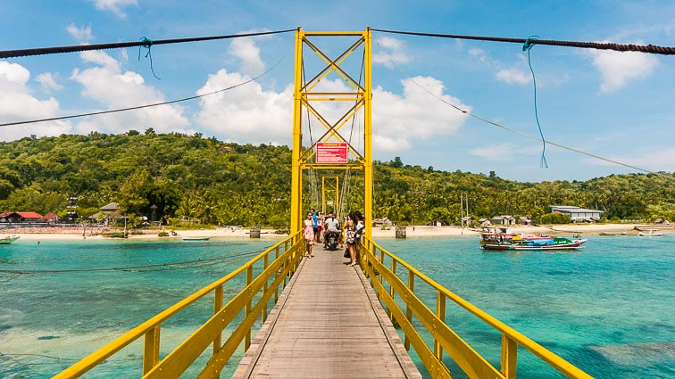 Bali Itinerary. Yellow suspension bridge between Nusa Lembongan and Nusa Ceningan