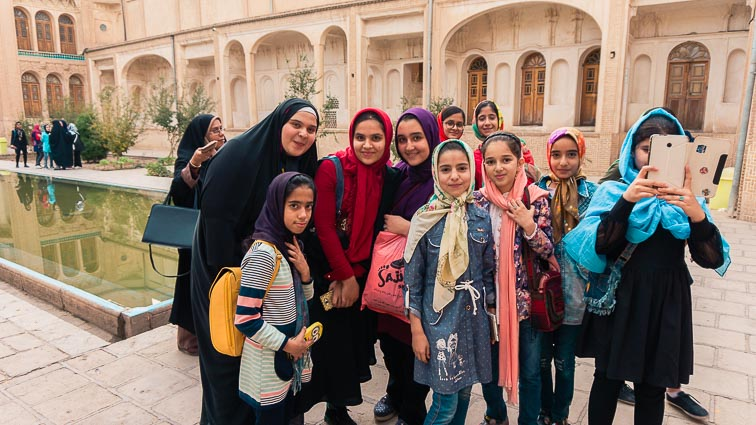 Appropriate clothing in Iran. What to wear in Iran. Taking photos with a class of girls