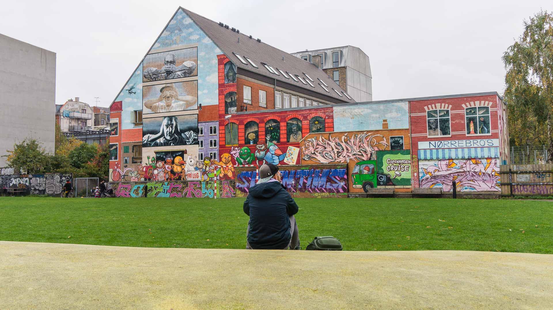 Erick gazing at the beautifully painted wall at Bananna Park