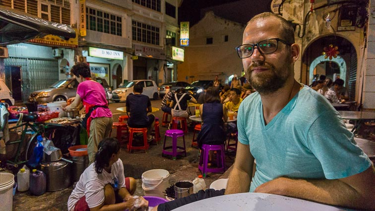 Erick on a pop up terrace in Georgetown, Penang. Eating is definitely one of the best things to do in Malaysia