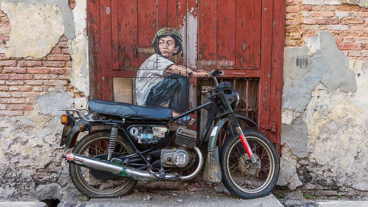 Kid on motorbike street art in Penang
