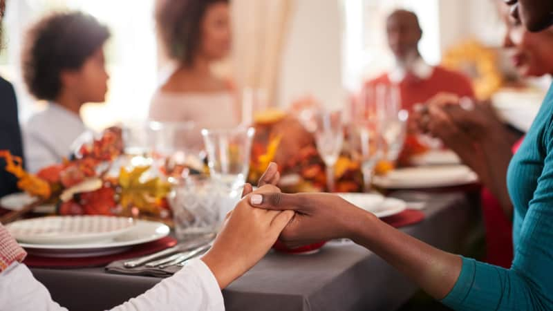 Joining hands around a crowded holiday table is best skipped this year.