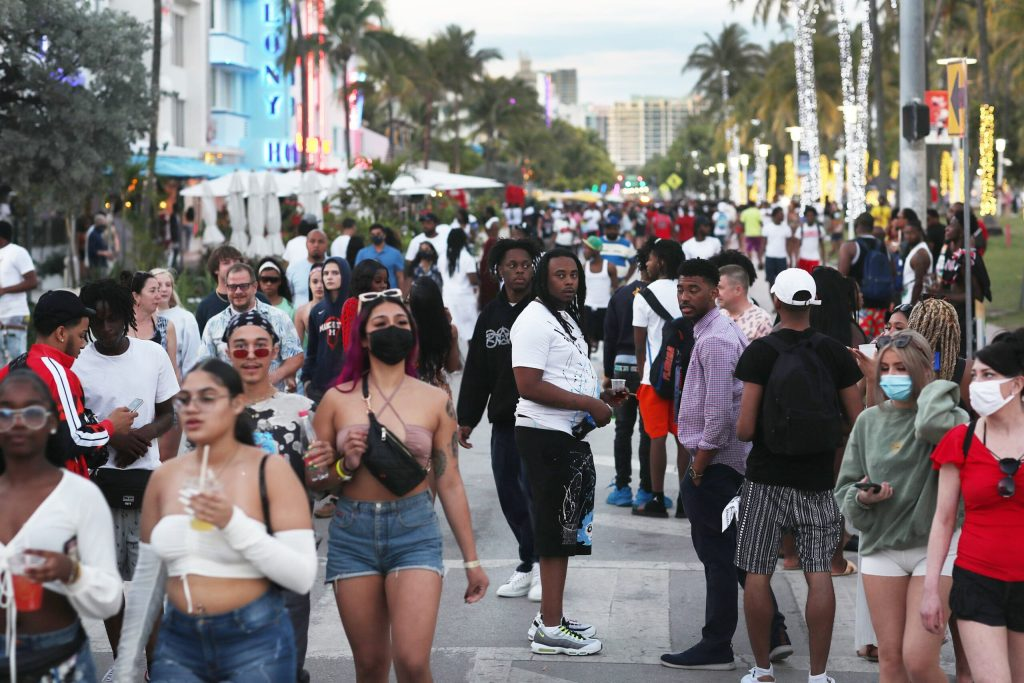 CDC advises against travel while spring break chaos worries some Miami Beach businesses trying to recover from pandemic