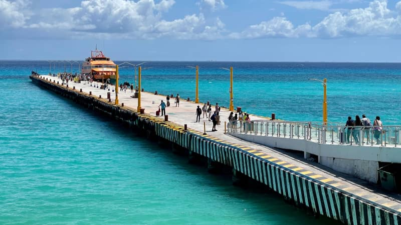 Tourists line up to board a boat in Playa del Carmen, Mexico on March 3, 2021. Mexico has some of the world's loosest travel rules.