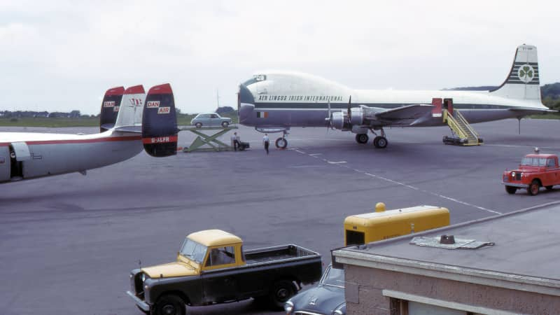 A car is loaded onto an Aer Lingus  Aviation Traders ATL-98 Carvair at Bristol Airport in the UK.