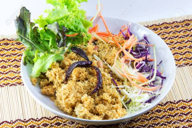 "Crispy catfish with green mango salad or ""yum pla dook foo"" Thai crusine"