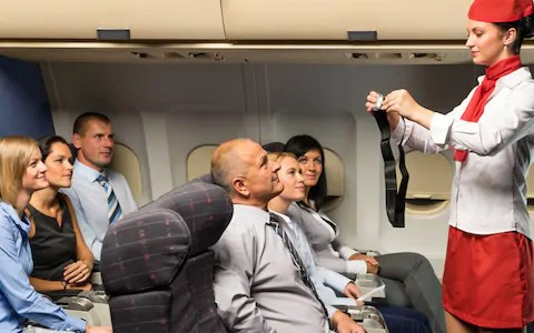 how to wear the seat belt on plane