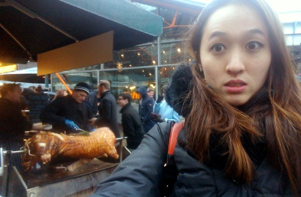 """Surprised"" face with the full roasted pig at Bourough Market"