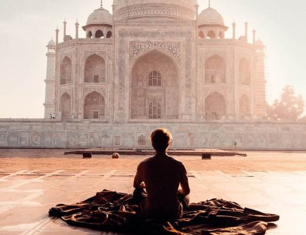 person meditating in india