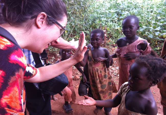 Jenn high-fiving kids at Bomido RPO