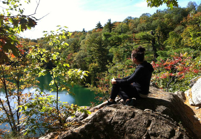 Jenn on a rock at Pink lake Gatineau Park