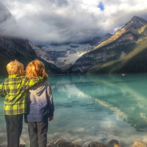 Brothers share a moment admiring Lake Louise