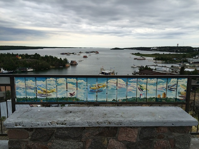 Yellowknife - view of float plane mural at Pilots' Monument and some of the houseboats you can see from there.