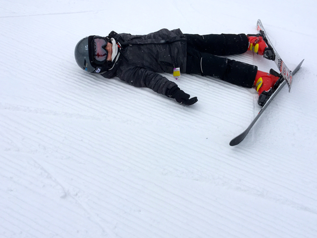 Boy resting on ski slope Jenn Smith Nelson