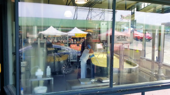 Cheese Making going on . View through Glass Window