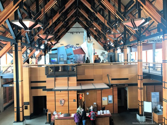 Inside view of Jackson Visitor Center at Paradise.  Rangers helping with information.