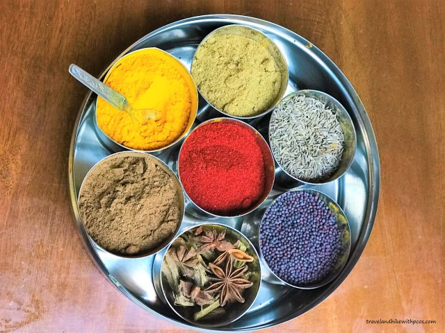 Indian Spice box - Turmeric, Coriander seeds powder, Cumin, Mustard Seeds, Star Anise, Garam Masala. Center - Chilly Powder Healthy Diet Plan for PCOS & Thyroid