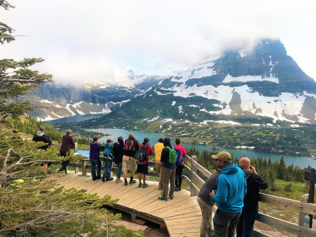 Visitors enjoying the beautiful view from Hidden Lake Lookout