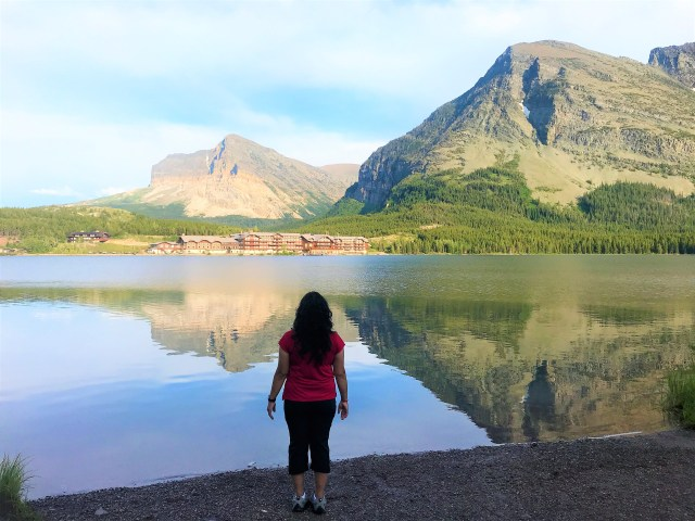 Reflections of Mountains in to Clear water of Swiftcurrent Lake Many Glacier