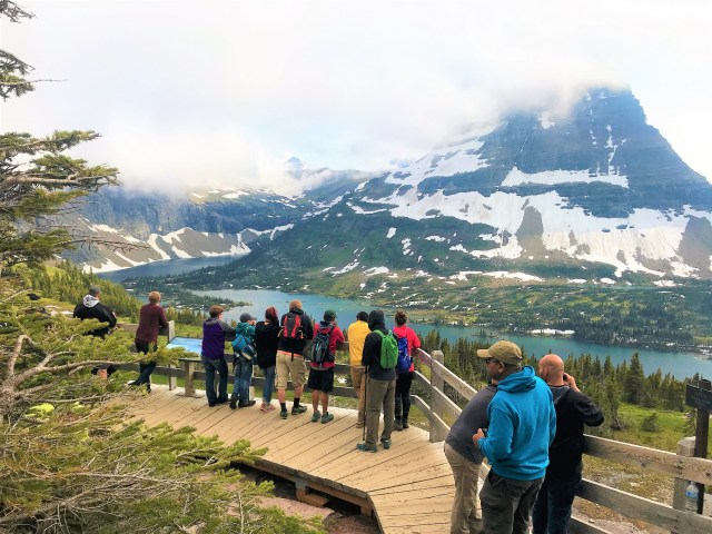 Visitors enjoying the beautiful view at Hidden Lake Lookout