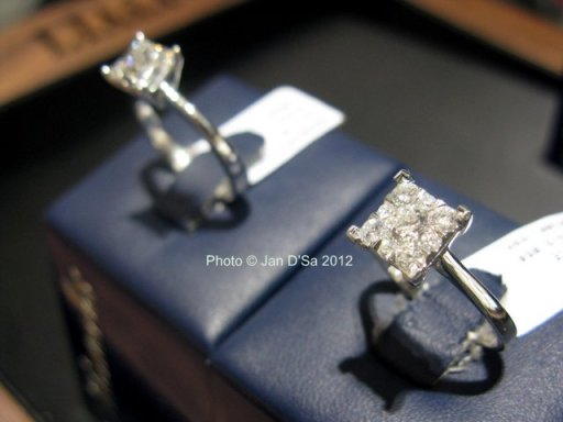 Comparing the Mirage Princess cut ring (right) with the solitaire diamond ring (left)