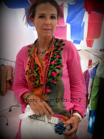 This French artisan posed with the jewelry and accessories that she makes