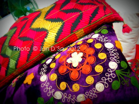 Clutches with a lot of thread work.