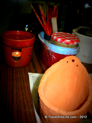 My pot in the foreground. The candle burner and wax in the background.