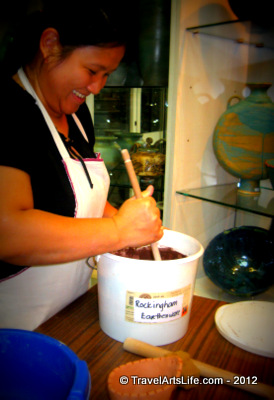 Mary, the assistant is mixing one of the glazes.