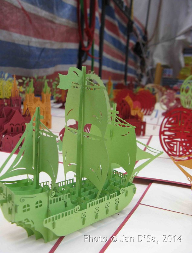 These are greeting cards with finely cut paper sculptures.