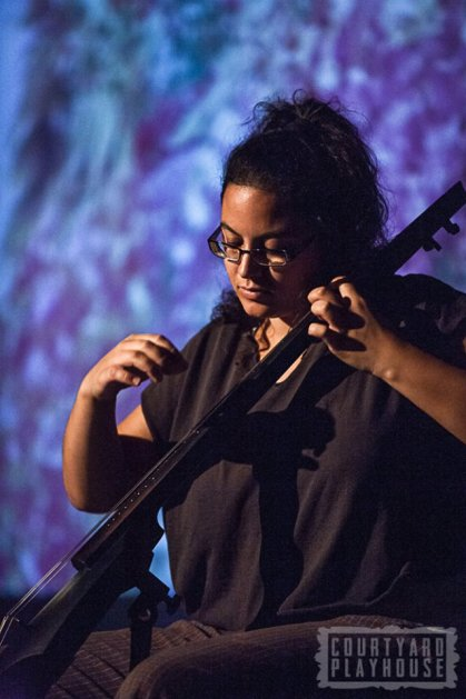 Isis M in musical action. Photo © Tiffany Schultz & The Courtyard Playhouse