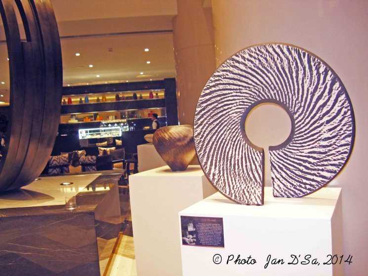 The zebra patterned sculpture by Michael Rice, as seen in the reception of Pullman Hotel