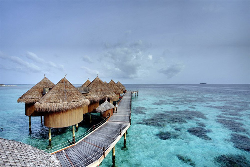 nika-island-maldives-resort-huts