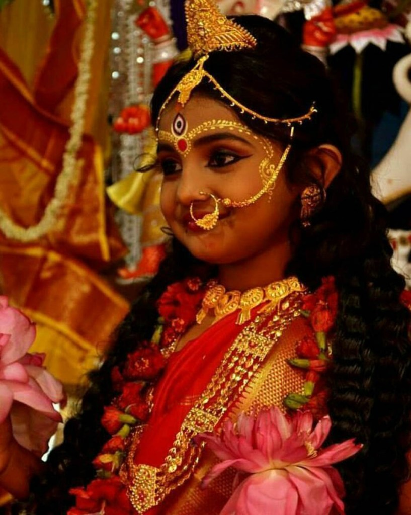 Young girl dressed to be worshipped as a Goddess on Kumari Puja