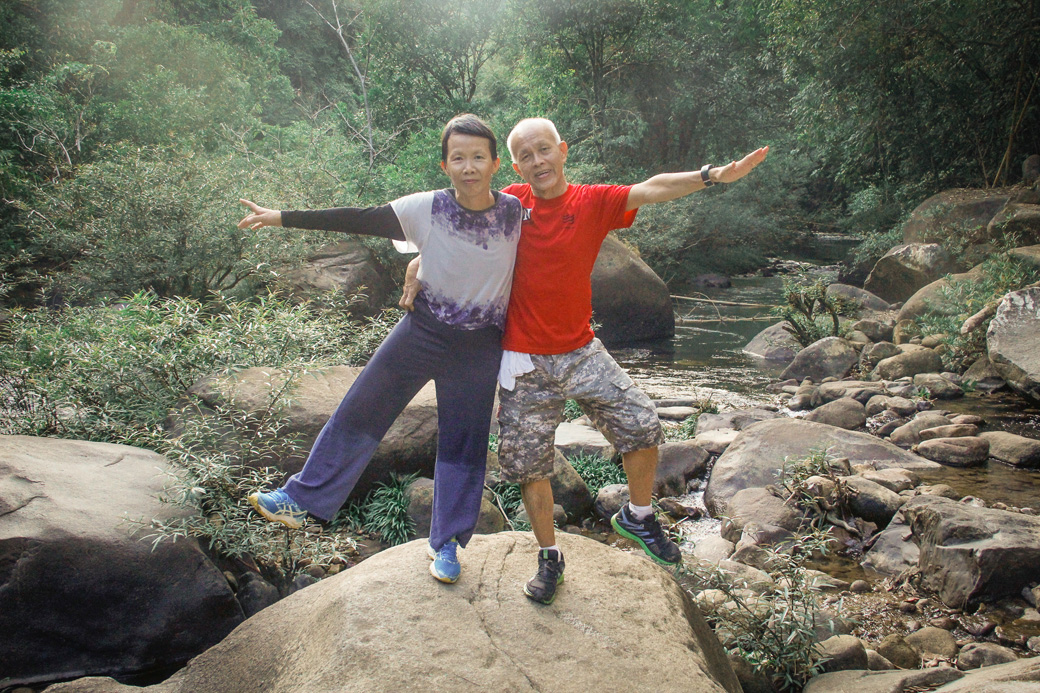 Parents posing on a hiking trail in Khao Sok National Park