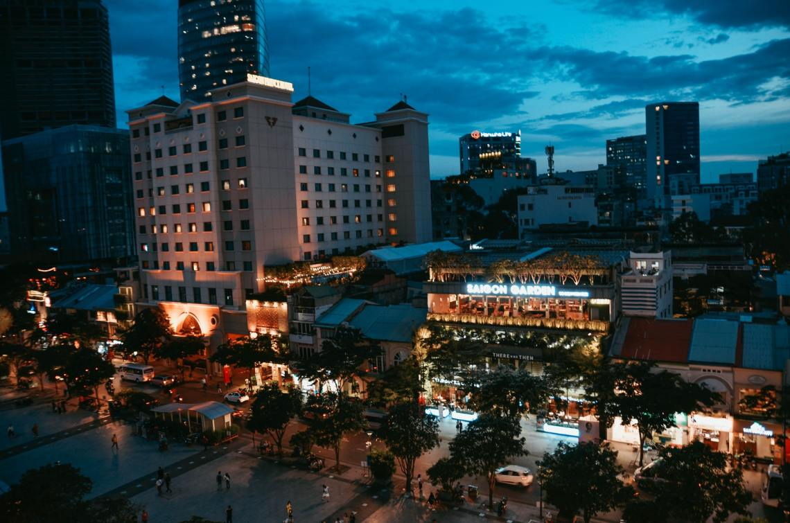 street with buildings and lights at night ho chi minh